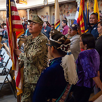 BU2 (SCW) Leroy Jimmy, carries the US Flag into Navajo Nation Council Chambers for the Fall Session, in Window Rock.