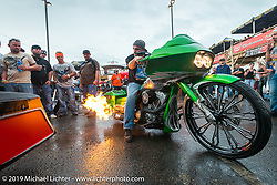 Throwing flames from a bagger at a very wet Easyriders Magazine Bike Show at the Easyriders Saloon during the annual Sturgis Black Hills Motorcycle Rally. SD, USA. August 5, 2014.  Photography ©2014 Michael Lichter.