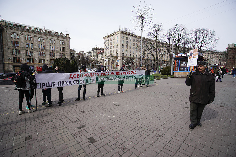 March 29, 2019 - Kiev, Ukraine - Right-wing youth hold a banner reading ''Ukraine is exhausted. Ukrainians treat their country worse than Poles did'' in central Kyiv, Ukraine on March 29, 2019. On Sunday Ukrainians will vote in the first round of the presidential elections in which a comedian is leading in the polls. (Credit Image: © Jaap Arriens/NurPhoto via ZUMA Press)