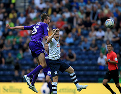 Preston North End's Tom Clarke (Right) and Stoke City's Peter Crouch contest a header.