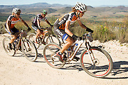 Ariane Kleinhans (front) and Annika Langvad of Team RECM2 pass the leading Grandmasters team Cycle Lab Toyota on the rusty gate climb during stage 5 of the 2014 Absa Cape Epic Mountain Bike stage race held from The Oak Estate in Greyton to Oak Valley Wine Estate in Elgin, South Africa on the 28 March 2014<br /> <br /> Photo by Greg Beadle/Cape Epic/SPORTZPICS