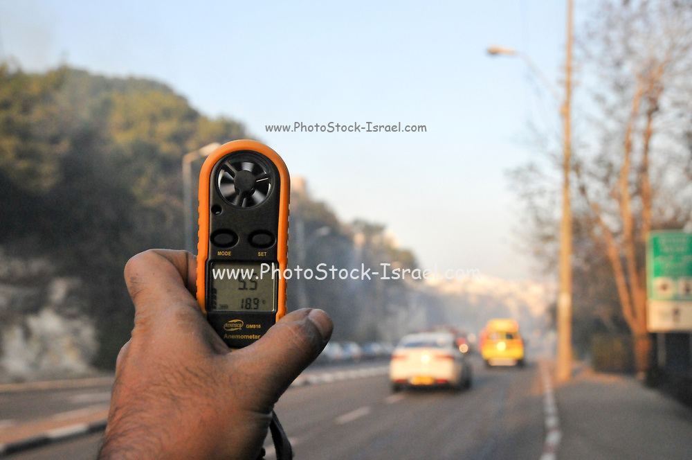 Hand held Anemometer and thermometer during the Wild fire in the city of Haifa, Israel in November 2016