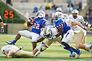 Dec 1, 2012; Tulsa, Ok, USA; Tulsa Hurricanes defensive back Darrell Williams (23) blocks as tailback Trey Watts (22) is brought down by University of Central Florida Knights defensive backs Nicco Whigham (30) and Sean Maag (31) as halfback Brendan Kelly (40) pursues during a game at Skelly Field at H.A. Chapman Stadium. Tulsa defeated UCF 33-27 in overtime to win the CUSA Championship. Mandatory Credit: Beth Hall-USA TODAY Sports