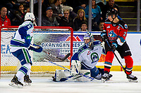 KELOWNA, BC - OCTOBER 16: Dillon Hamaliuk #22 of the Kelowna Rockets looks for rebound on Isaac Poulter #1 of the Swift Current Broncos as he defends the net and makes a save during first period at Prospera Place on October 16, 2019 in Kelowna, Canada. (Photo by Marissa Baecker/Shoot the Breeze)