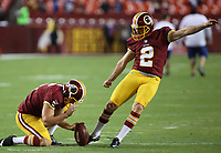 September 25, 2014: Washington Redskins punter Blake Clingan (5) holds for Washington Redskins kicker Kai Forbath (2) before a match between the Washington Redskins and the New York Giants at FedEx field in Landover, Maryland. NFL American Football Herren USA SEP 25 Giants at Redskins PUBLICATIONxINxGERxSUIxAUTxHUNxRUSxSWExNORxONLY Icon14092550<br /> <br /> September 25 2014 Washington Redskins Punter Blake Clingan 5 holds for Washington Redskins Kicker Kai Forbáth 2 Before A Match between The Washington Redskins and The New York Giants AT FedEx Field in Landover Maryland NFL American Football men USA Sep 25 Giants AT Redskins PUBLICATIONxINxGERxSUIxAUTxHUNxRUSxSWExNORxONLY