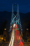 Rush hour traffic crossing the Lions Gate Bridge from Stanley Park in Vancouver, British Columbia, Canada to North Vancouver in the early evening. Photographed from the bridge on Stanley Park Drive.