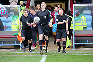 Referee Scott Oldham leads the two teams out for the EFL Sky Bet League 1 match between Scunthorpe United and Plymouth Argyle at Glanford Park, Scunthorpe, England on 27 October 2018. Pic Mick Atkins