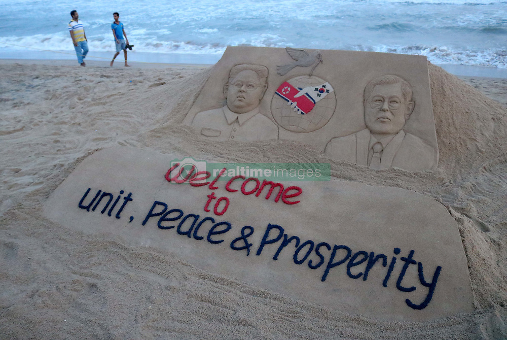 April 28, 2018 - Bhubaneswar, India - Indian Sand artist Sudarsan Pattnaik created a sand sculpture on the historic meeting of both the president of North Korea and South Korea with message ''Welcome to Unit, Peace and prosperity'' at the Bay of Bengal Sea's eastern coast beach at Puri, 65 km away from the eastern Indian state Odisha's capital city Bhubaneswar, on 28th April 2018. (Credit Image: © Str/NurPhoto via ZUMA Press)