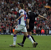 Photo: Paul Thomas.<br /> Blackburn Rovers v Liverpool. The Barclays Premiership. 16/04/2006.<br /> <br /> Blackburn's Morten Gamst Pederson is tried to be held back by referee Mr A Wiley as he runs towards the lineman yelling abuse after Robbie Fowler scores for Liverpool.
