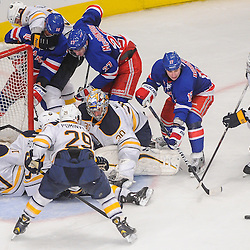 New York Rangers left wing Brandon Dubinsky (17) and Buffalo Sabres left wing Marcus Foligno (82) chase down the puck following a scramble to recover Buffalo Sabres goalie Ryan Miller's (30) rebound during third period NHL action between the Buffalo Sabres and the New York Rangers at Madison Square Garden in New York, N.Y. The Sabres defeated the Rangers 4-1.