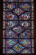 Medieval stained glass Window of the Gothic Cathedral of Chartres, France - dedicated to the Life and Miracles of St Nicholas. A UNESCO World Heritage Site. .<br /> <br /> Visit our MEDIEVAL ART PHOTO COLLECTIONS for more   photos  to download or buy as prints https://funkystock.photoshelter.com/gallery-collection/Medieval-Middle-Ages-Art-Artefacts-Antiquities-Pictures-Images-of/C0000YpKXiAHnG2k