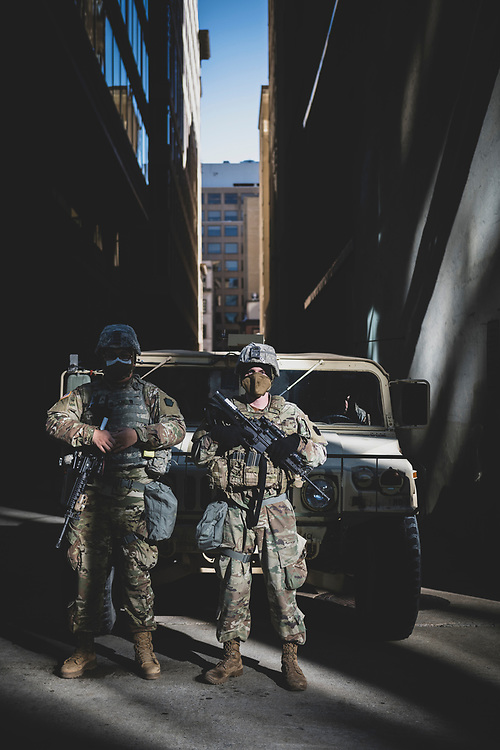 Washington DC, USA - January 19, 2021: Members of the Pennsylvania National Guard stand outside their humvee parked in an alley several blocks from the White House.
