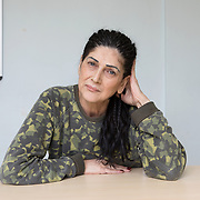 """Milan, Italy, 8 April 2019. San Vittore prison. Françoise, 52, born in France. <br /> """"Before arriving in San Vittore, where I have been now for three months, I went to Verziano prison for 2 years. There I started writing a book about my life, which is almost an autobiography. Only 30% is based on my imagination, the rest, the truth, is very strong, precisely because it concerns me. In that book there is everything: my pain, my anger. Since I arrived in Milan I have stopped writing the book, but I will certainly finish it one day""""."""