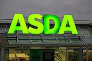 Asda superstore sign lit up at night, Falmouth, Cornwall, UK