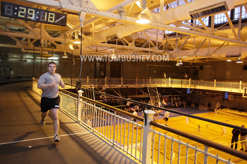 A cadet finishes the the Indoor Obstacle Course Test in Hayes Gym at the U.S. Military Academy at West Point on Feb. 9, 2010.