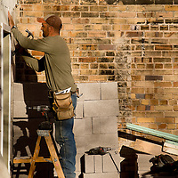 112612     Brian Leddy<br /> Jose Servantes touches up the exterior of building that faces an alleyway in downtown Gallup Monday afternoon.