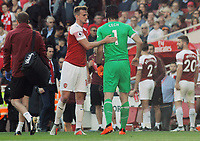 FOOTBALL - 2018 / 2019 Premier League - Arsenal vs. Watford<br /> <br /> Arsenal goalkeeper, Petr Cech is consoled by Rob Holding as he leaves the field injured, at the Emirates<br /> <br /> COLORSPORT/ANDREW COWIE
