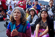 """jku032303051 - 31 JULY 2002 - MEXICO CITY, DF, MEXICO: People pray on the Zocalo in the historic center of Mexico City during a Papal mass televised to the Zocalo on large screen """"jumbotron"""" televisions. The mass, led by Pope John Paul II, was at the Basilica of Guadalupe in Mexico City, July 31, 2002. The Pontiff, making his fifth trip to Mexico, canonized Juan Diego, the Mexican Indian who first saw the image of the Virgin of Guadalupe in 1531. Juan Diego is now known at Saint Juan Diego. PHOTO © JACK KURTZ  RELIGION  INDIGENOUS  CULTURE  PATRIOTISM"""