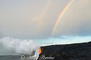 a double rainbow touches down where hot lava from the 61G flow from Kilauea Volcano enters the ocean from the open end of a lava tube at the Kamokuna entry in Hawaii Volcanoes National Park, producing a great cloud of steam, Kalapana, Puna, Hawaii Island ( the Big Island ), Hawaiian Islands, U.S.A.