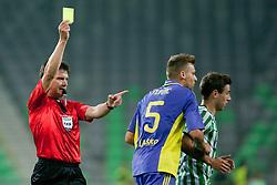 Referee Matej Jug gives a yellow card to Zeljko Filipovic #5 of Maribor during football match between NK Olimpija and NK Maribor in 5th Round of Prva liga NZS 2012/13, on August 11, 2012 in SRC Stozice, Slovenia. (Photo by Matic Klansek Velej / Sportida.com)