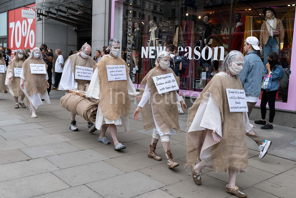 Supporters of environmental and Climate Change group Extinction Rebellion, protest aginst the ethics of the fashion industry outside TopShop at Oxford Circus, on 9th September 2020, in London. XR say that the fashion industry produces around 10% of all humanity's carbon emissions, more than all international flights and maritime shipping combined and that over 800,000 tonnes of discarded textile waste annually in the UK.