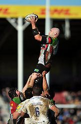 George Robson (Harlequins) wins lineout ball - Photo mandatory by-line: Patrick Khachfe/JMP - Tel: Mobile: 07966 386802 01/03/2014 - SPORT - RUGBY UNION - The Twickenham Stoop, London - Harlequins v Worcester Warriors - Aviva Premiership.