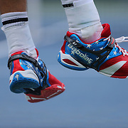 Andy Roddick, USA, serving in his stars and stripes tennis shoes against Fabio Fognini, Italy, during the US Open Tennis Tournament, Flushing, New York. USA. 2nd September 2012. Photo Tim Clayton