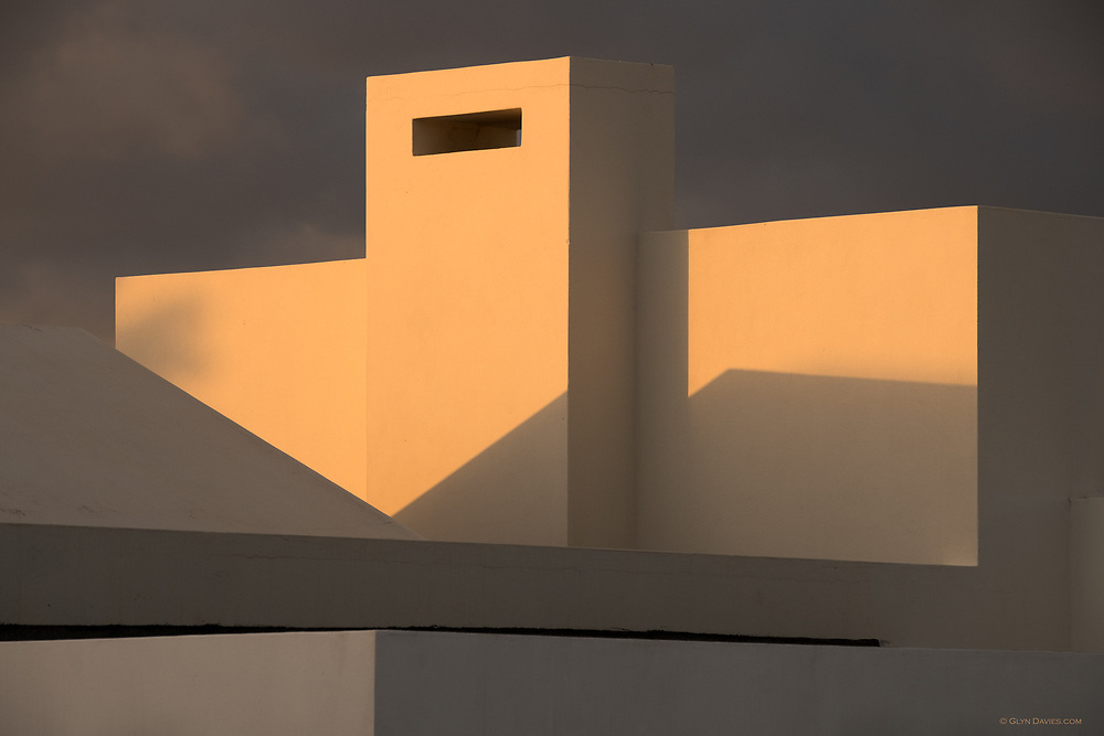 Honourable Mention in 14th (2021) International Colour Awards (Architecture category)<br /> <br /> Shortlisted for British Photography Awards 2019<br /> <br /> Evening sunlight catching the rooftops of the single storey buildings in Playa Blanca