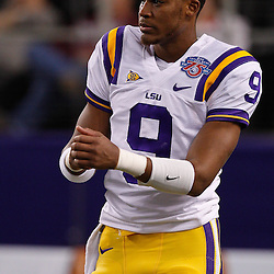 Jan 7, 2011; Arlington, TX, USA; LSU Tigers quarterback Jordan Jefferson (9) during warm ups prior to kickoff of the 2011 Cotton Bowl against the Texas A&M Aggies at Cowboys Stadium. LSU defeated Texas A&M 41-24.  Mandatory Credit: Derick E. Hingle