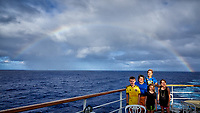 Rainbow over a family on the aft deck of the MV World Odyssey.  Image taken with a Leica T camera and 11-23 mm lens (ISO 100, 12 mm, f/14, 1/125 sec).