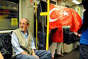 BERLIN, GERMANY - 26/06/2008 - TRAVEL, Scene in the metro the day after Germany and Turkey played EK half finals..cfr. Berlin, Germany, capital, Turkish flag, metro, public transport..©Christophe VANDER EECKEN