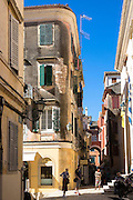 Tourists in street scene by Church of Saint Spyridon in Agiou Spiridonos in Kerkyra, Corfu Town, Greece