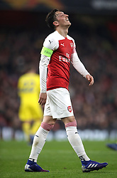 Arsenal's Mesut Ozil rues a missed chance during the UEFA Europa League round of 32 second leg match at the Emirates Stadium, London.