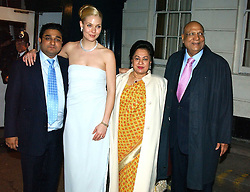 Left to right, the HON.ANGAD PAUL, his bride MICHELLE BONN and LORD & LADY PAUL leaving a reception to celebrate the wedding of Lord Paul's youngest son Angad to Michelle Bonn held at Lancaster House, London on 21st March 2005.<br /><br />NON EXCLUSIVE - WORLD RIGHTS