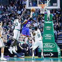 08 December 2012: Philadelphia 76ers point guard Maalik Wayns (18) goes for the reverse layup past Boston Celtics power forward Brandon Bass (30) and Boston Celtics point guard Rajon Rondo (9) during the Boston Celtics 92-79 victory over the Philadelphia 76ers at the TD Garden, Boston, Massachusetts, USA.