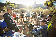 SHOT 10/15/16 8:40:33 AM - Breakfast on the White Rim Trail. The White Rim is a mountain biking trip in Canyonlands National Park just outside of Moab, Utah. The White Rim Road is a 71.2-mile-long unpaved four-wheel drive road that traverses the top of the White Rim Sandstone formation below the Island in the Sky mesa of Canyonlands National Park in southern Utah in the United States. The road was constructed in the 1950s by the Atomic Energy Commission to provide access for individual prospectors intent on mining uranium deposits for use in nuclear weapons production during the Cold War. Four-wheel drive vehicles and mountain bikes are the most common modes of transport though horseback riding and hiking are also permitted.<br /> (Photo by Marc Piscotty / © 2016)