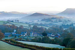 © Licensed to London News Pictures. 06/11/2016. Llanddewi'r Cwm, Powys, Wales, UK. Frost and mist surround the small village of Llanddewi'r Cwm in Powys, Wales, UK. beforew dawn. Temperatures dropped to zero degrees centigrade last night in Powys, Wales, UK. Photo credit: Graham M. Lawrence/LNP