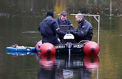 © Licensed to London News Pictures. 11/11/2020. London, UK. Police use an inflatable boat equipped with sonar to search Highgate Ponds in north London as part of an investigation dating back to 2013 for missing man Robert Duff. The Metropolitan Police have said that detectives investigating the disappearance of the 37-year-old man from Kilburn nearly eight years ago are continuing to appeal for information. The latest strand of the investigation will see dive teams search a pond area in Highgate after information was received that Robert Duff's body could be concealed in the water. Robert, who would now be aged 45, has not been seen or heard from since 12 January 2013 when he failed to attend a family celebration for his daughter's 18th birthday. Photo credit: Peter Macdiarmid/LNP