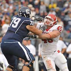 Oct 31, 2009; East Hartford, CT, USA; Connecticut tackle Mike Hicks (79) blocks Rutgers defensive end Alex Silvestro (45) during second half Big East NCAA football action in Rutgers' 28-24 victory over Connecticut at Rentschler Field.
