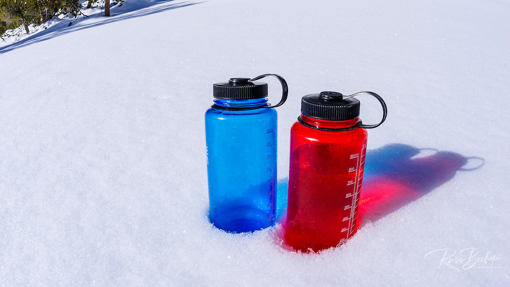 Water bottles on snow, John Muir Wilderness, Sierra Nevada Mountains, California  USA