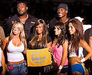 San Diego, California, USA - Players for the San Diego Seduction huddle before a play against the Dallas Desire  in a Lingerie Football League game at the San Diego Sports Arena.<br /> ©KC Alfred/Exclusivepix)