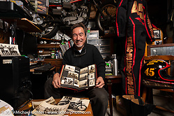Custom bike builder Keiji Kawakita shows off his heritage with a family photo album filled with pictures of his professional racing father on the track in the 1940-50s at his Hot Dock Customs in Tokyo during out Mooneyes Japan tour. Friday, November 30, 2018. Photography ©2018 Michael Lichter.