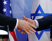 U.S. Secretary of State Mike Pompeo and Israeli Prime Minister Benjamin Netanyahu shake hands as they deliver joint statements during their meeting in Jerusalem.  REUTERS/Jim Young