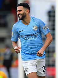 Manchester City's Riyhad Mahrez celebrates scoring his side's first goal of the game during the Premier League match at The Vitality Stadium, Bournemouth.