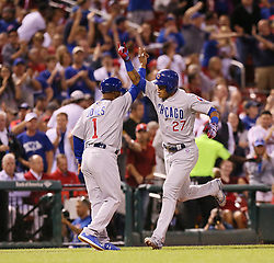 September 27, 2017 - St. Louis, MO, USA - The Chicago Cubs' Addison Russell (27) celebrates with third base coach Gary Jones (1) after hitting a three-run home run in the seventh inning against the St. Louis Cardinals on Wednesday, Sept. 27, 2017, at Busch Stadium in St. Louis. The Cubs clinched the N.L. Central Division title with a 5-1 victory. (Credit Image: © Chris Lee/TNS via ZUMA Wire)