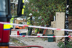 © London News Pictures. 28/10/2013 . London, UK.  National Grid workers at the scene where a gas explosion at a house was caused by a falling tree in heavy wind, hospitalising at least three people. Gusts of 99mph have been recorded as a storm continues to batter parts of England and Wales. Photo credit : Ben Cawthra/LNP