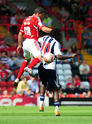 Bristol City's James Wilson battles for the high ball West Bromwich Albion's Somen Tchoyi  - Photo mandatory by-line: Joseph Meredith / JMPUK - 30/07/2011 - SPORT - FOOTBALL - Championship - Bristol City v West Bromwich Albion - Ashton Gate Stadium, Bristol, England