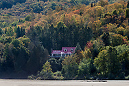 A house with a great view of Plage Brébeuf (Brébeuf Beach) along the  Rivière-Rouge (Red River) in the Village of Brébeuf, Québec, Canada.