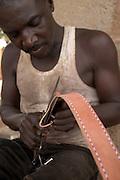 Man making leather belt in Tamale, Northern Ghana.