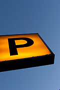 Sign to the entrance to a Parking area.